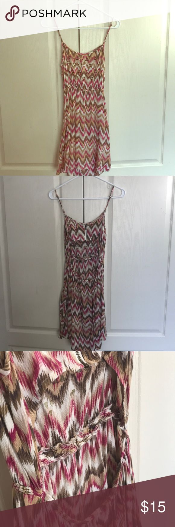 Urban Outfitters Summer Dress Adorable summer dress with Aztec pattern. Slightly worn. Cute gold detailing on chest. Thin straps. Shorter in front & longer in back. There is a cut-out on the lower back. I am 5'9 & the dress hits about mid thigh. Perfect for wearing during the day or an evening out. Dress is from Urban Outfitters. Lucca Couture Dresses Mini