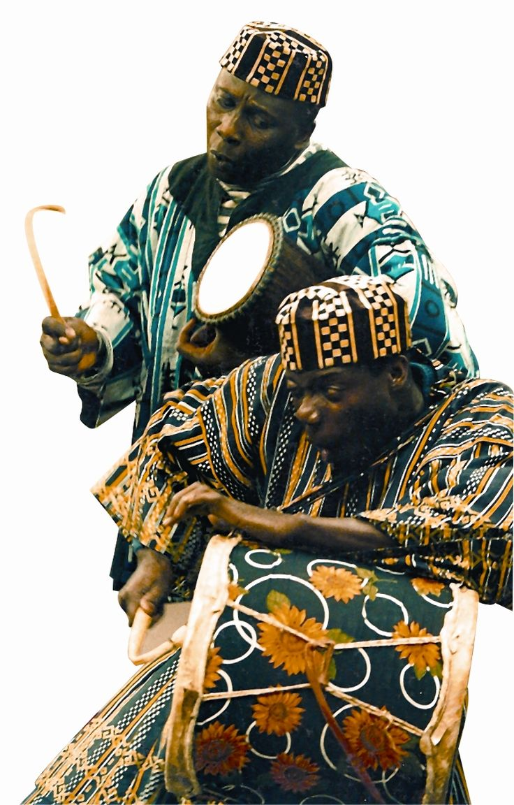 Ghana, talking drum. The man standing looks like one of my professors in college, Kwame Ansah-Brew. I wouldn't be surprised if it was him.
