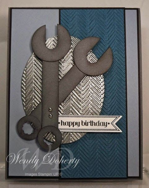 handmade birthday card from Stamping Styles ... masculine look ... punch art wrenches ... background oval of silve embossed in herringbone texture ... grays and gray/blue ... luv it! ... Stampin'Up!