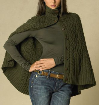 "A classic fisherman's sweater is reinterpreted in a stunning, subtly slouchy cape silhouette, knit in a heritage Aran pattern from the finest Italian yarns. * Soft, luxurious wool and cashmere. * Full-button front with nine wood buttons. * Wide-ribbed turtleneck collar and hem. * 28"" length. * 70% wool, 30% cashmere. Now I just have to find a pattern to create."