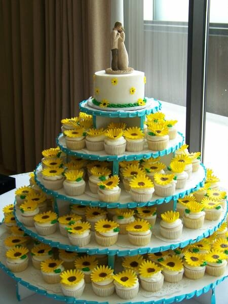 OMG this is almost my wedding cake! I had the exact same cake topper and I had cupcake tiers with daisies on them! Amazing...I love the sunflowers too :)