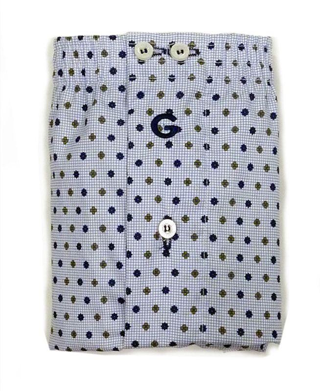 Boxer de tela para hombre. Cinturilla elástica forrada a juego y cerrada con dos botones. Parte posterior con pieza completa o corte americano. Algodón 100%