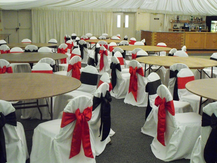 Alternating Black and Red Satin Bows on White Chair Covers