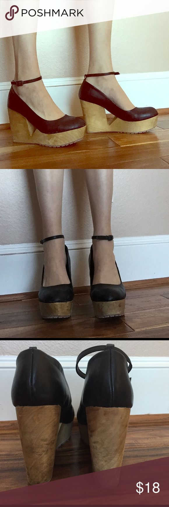 Wooden cutout platforms with ankle strap Deena&Ozzy wooden platforms w triangular cutout & ankle strap. Very comfortable !! Size 10. The wooden platform has a few scratches but they are in pretty good condition Deena & Ozzy Shoes Platforms