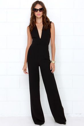 LuLu*s Exclusive! You'll cause some serious outfit envy when you strut your stuff in the Cat's Meow Black Jumpsuit! Medium-weight stretch woven fabric begins with a plunging V neckline at the forefront of a sleeveless bodice. Thick shoulder straps crisscross, leaving an open back that ends at the elastic waist, all above trendy, wide-cut pant legs that complete the flattering silhouette.