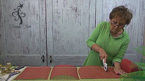 Crafting tools for wreath  making - self-healing cutting mat and Fiskars Rotary Stick Cutter....great timesaver