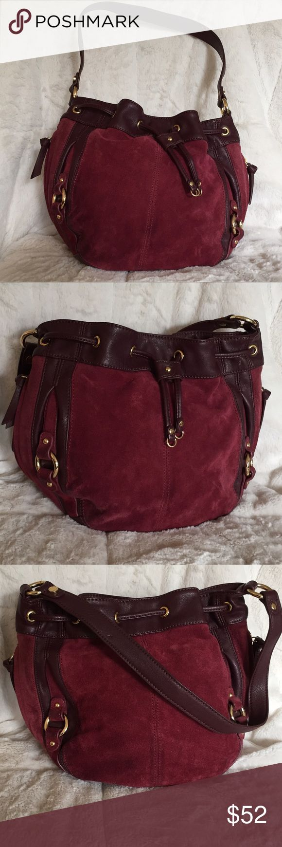 """🍁Tignanello Wine Suede and Leather Bucket Bag. This is such a nice bag, has slight wear where the Suede meets the leather on the bottom. Inside extremely clean. Sides have a vertical zippered pocket. Drawstring and magnet closure. Zippered pocket inside and pouches for cell phone. 10""""H x 12""""L x 6""""W Strap drop 10"""" Wine color Tignanello Bags Shoulder Bags"""