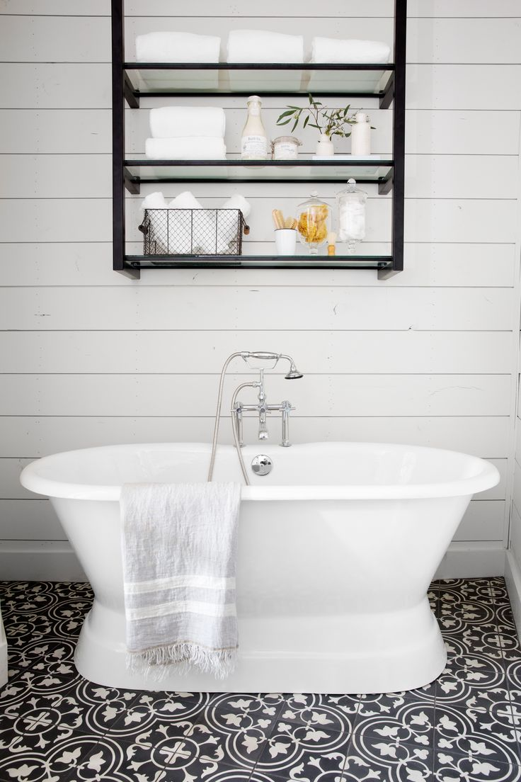 """As much as I love white subway tile and white shiplap, I know when there's too much white. This floral tile is bold, but the black color keeps it feeling classic,"" says Joanna Gaines of the patterned tile."