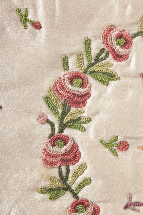 Detail of tambour embroidery, uncut waistcoat, France, c. 1760. Cream silk satin with multicoloured silk embroidery.