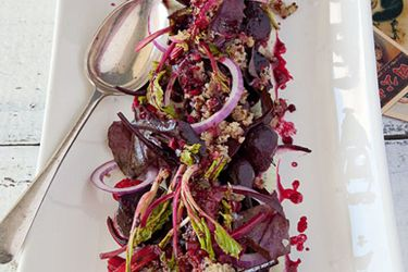 Warm quinoa salad with cumin, roast beetroot and a creamy mint dressing