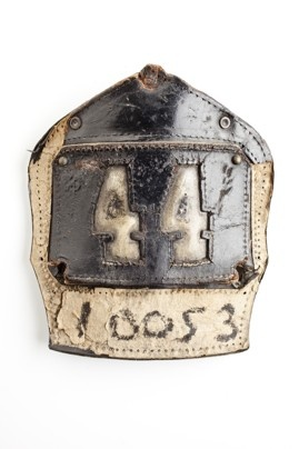 A badge from a fire helmet discovered in the debris.  Ira Block / National September 11 Memorial & Museum