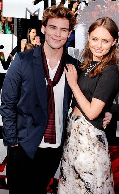 Sam Claflin and Laura Haddock attend the 2014 MTV Movie Awards