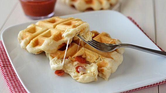 Pillsbury® Grand® Flaky Layers Biscuits are transformed into pizza waffles! Mini golden waffles stuffed with melty cheese and pepperoni. These will be a hit with everyone!