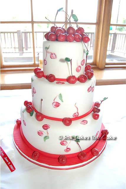 Hand painted cherries to mimic her invitations. Marzipan hand rolled cherries for full effect. wedding cake