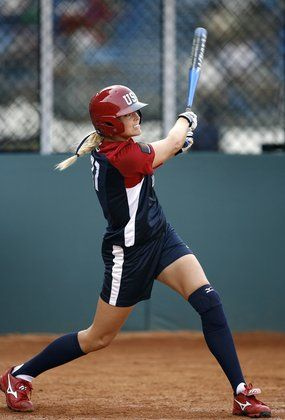 Jennie Finch follows through on a hit