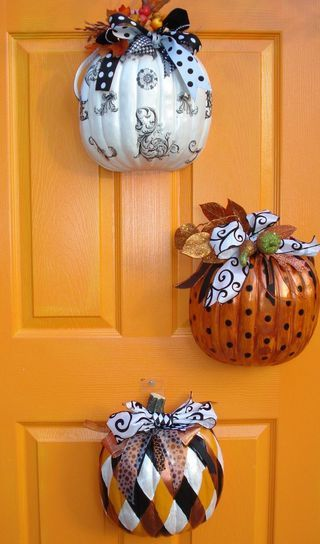Pumpkins for Halloween decor - cut cheap pumpkins in half, paint, add ribbons and accessories, and hang.