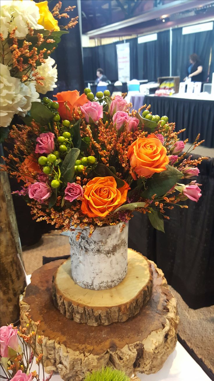 "Natural and rustic centerpiece created by ""WOW"" Event Design & Coordination! Birch centerpiece has orange roses, baby pink roses and other greens. Beautiful bright colors and awesome as a centerpiece in any season!"
