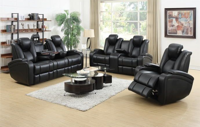 """2 pc Delange collection transitional style black padded faux leather upholstered power motion sofa and love seat with recliner ends. This set includes the Sofa and love seat power motion recliner ends, with lighted cup holders and a flip up reading light on the center console of the sofa.  Sofa measures 85"""" x 40.25"""" x 41.75"""" H. Love seat measures 73.25"""" x 40.25"""" x 41.75"""" H. Optional single recliner available at additional cost and measures 38.5"""" x 40.25""""..."""