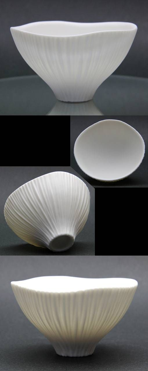 This has a very unique and interesting shape. The shape of the top of it reminds me of moving water.