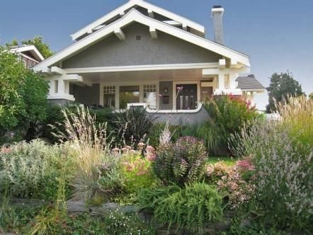 Sounds like my house exactly: Craftsman-style home wanted a garden that would maintain the style typical of the period and include a dining patio, lawn, plantings, and dog run. However, the small property had a sloping yard and very limited space.