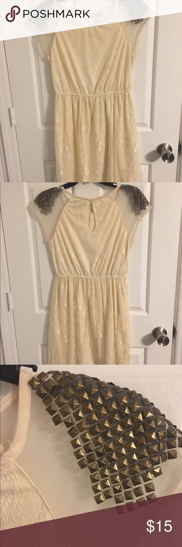 Cream Mini Dress Cream lacy mini dress. Shear shoulders with bronze embellishments. Worn once, great condition. Such an adorable dress; I love it! Pinky Dresses Mini