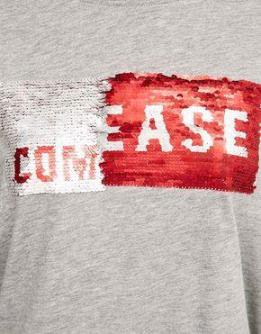 Camiseta con texto de lentejuelas reversible. Descubre ésta y muchas otras…