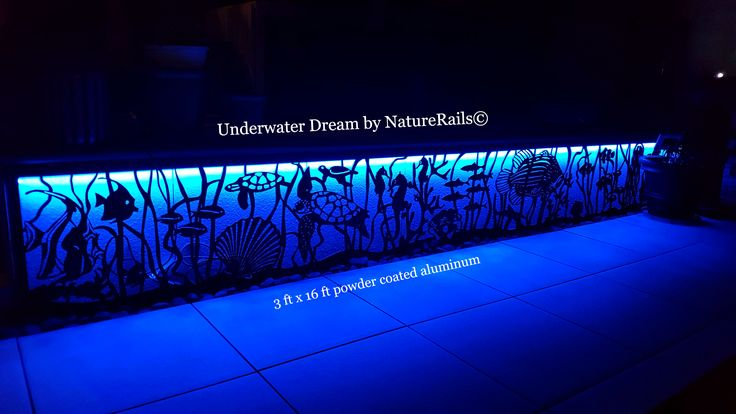 Backyard fish tank that never needs cleaning? We did it! An amazing underwater metal panel was created in powder coated aluminum with blue backlights. The panel is 3ft x 16ft and will never need maintenance. Put some Wow in your #porch or #deck project!  We can design anything, in any size. Created by professional nature artist Rob Gerdin of NatureRails©.