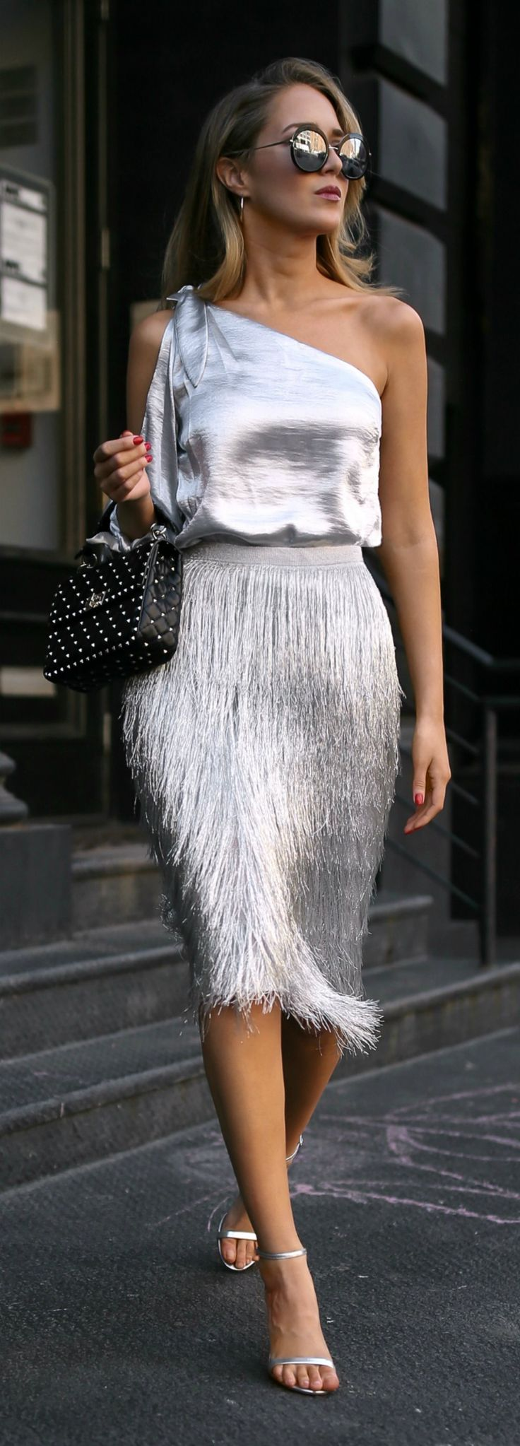 Click for outfit details! One shoulder metallic blouse, metallic fringed midi sk…