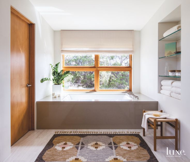 Simple Master Bathroom with Large Tub and Rug