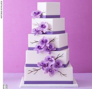 Square fondant cake stacked at an angle and accented with lavender bands and orchids by Mark Joseph Cakes, MarkJosephCakes.com  > Find your wedding cake baker