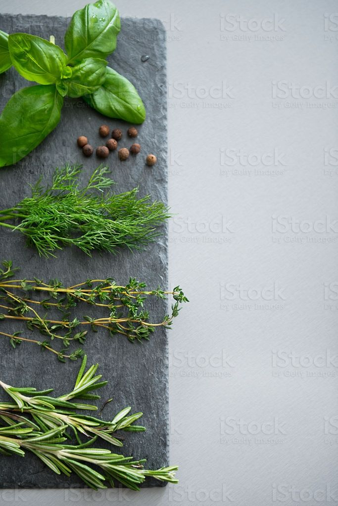 Fresh spices herbs on stone substrate. Closeup royalty-free stock photo