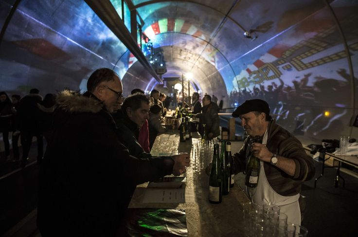 Lyon, France People taste wine during the first International Taste Biennial in the Croix-Rousse tunnel