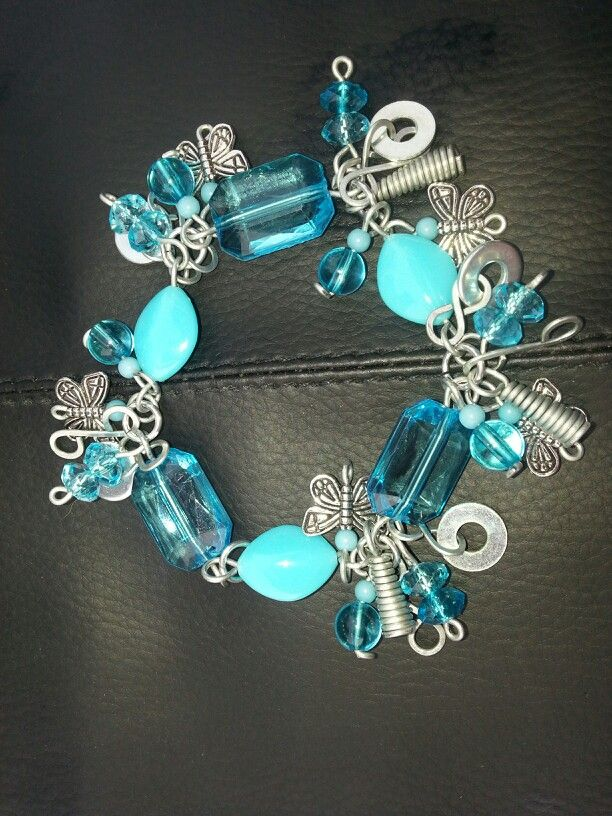 Blue Ice Charm Bracelet; handcrafted (including all findings), from 20 guage galvanized steel wire and acylic beads.