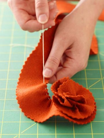 how to make these fabric flowers -- meant for pillow embellishment in the article, but hello, flower hair clips!
