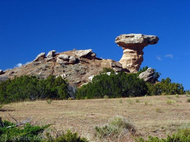 Camel Rock, New Mexico. We drove past here.  If memory serves me correctly, it is opposite the Camel Rock Indian Casino.