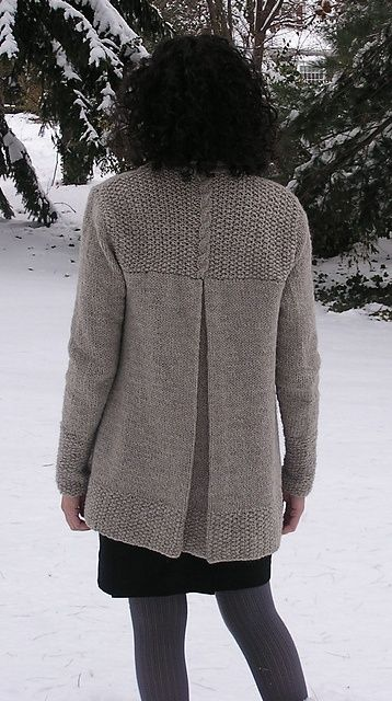 This is the London Bridges Cardigan and can be found on Ravelry.