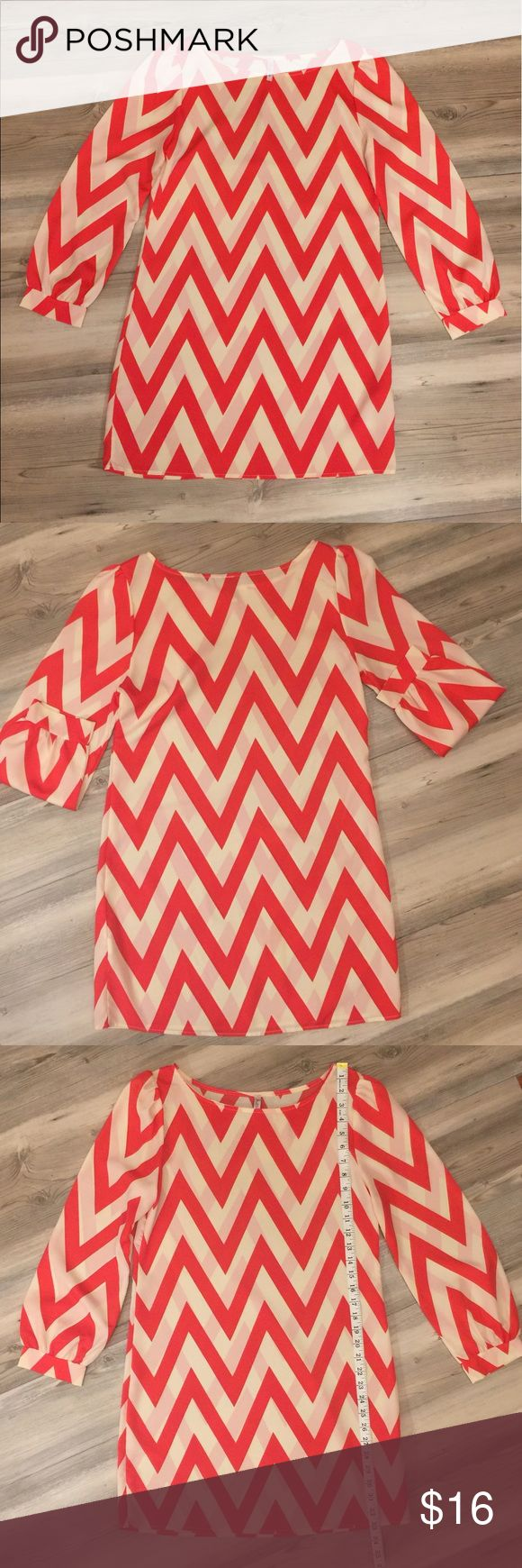 Orange & white chevron dress EUC ‼️ This orange & white chevron print dress is by Auditions in a size M!  The material is 100% polyester.  Please see pics for measurements! Auditions Dresses