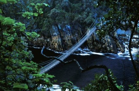 The Storms River area (Garden Route, South Eastern Cape) is known for its wild beauty and stormy seas. The Storms River mouth is adjacent to the Tsitsikamma National Park.  The suspension bridge is an easy stroll that leads along the western side of the river mouth, past the Strandloper Cave. On the other side of the bridge, there is a short but very steep climb to a lookout point with excellent views over the river mouth.