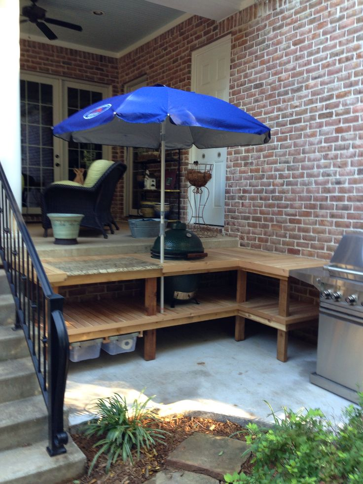 Our newly constructed outdoor cooking area for Big Green Egg and grill--complete with umbrella