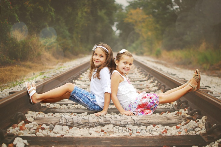 LOVE these sweet sisters on the railroad