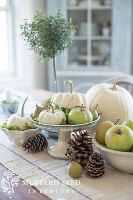 Yikes--editor needs to spell decorating correctly! Put it on a pedestal, Just about anything, even humble apples, pumpkins and pinecones can look important when elevated on a pedestal.  I like using compotes, footed bowls and cake stands in arrangements for just this reason.  It also adds height, which creates visual interest.