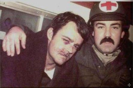 Argentinian medic hugs the british RAF pilot Jeff Glover.    Falklands War.