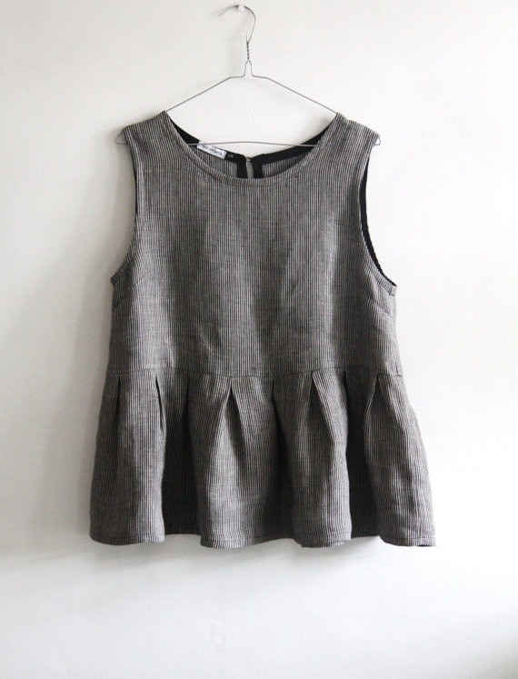 Simple tank top, truncated and finished with a pleated skirt. Pleats are widely spaced, but each pleat is deep enough to create presence.