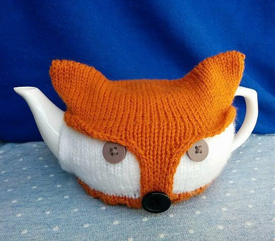 Free knitting for Fox Tea Pot Cozy - Beverley Laundry's cozy is made from a rectangular shape fastened with buttons that create a fox face when fitted around the tea pot. Note — I couldn't get to the original site so this is a link to the archive.