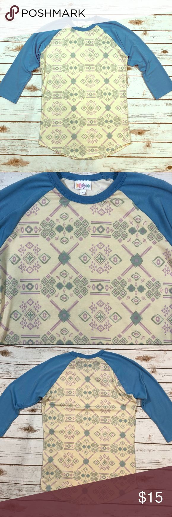 Lularoe Aztec Print Randy - Small LuLaRoe Womens Small Randy Raglan Baseball Tee Shirt Ivory Blue Aztec Print  Labeled a size Small.   Very good preowned condition. Slight pilling under arms. Otherwise, no flaws to note. LuLaRoe Tops