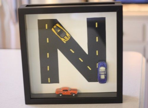 Super cute shadow box with hot wheels and letter road. Must make this for my little man's room!