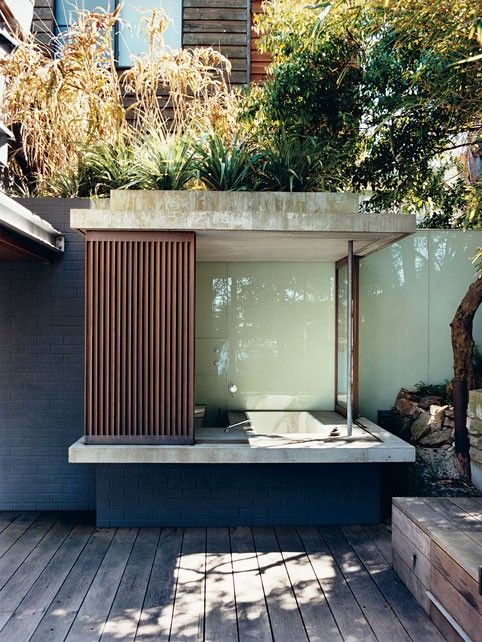 I like the idea of a hot tub with a roof and perhaps some shutters or curtains... romantic and private