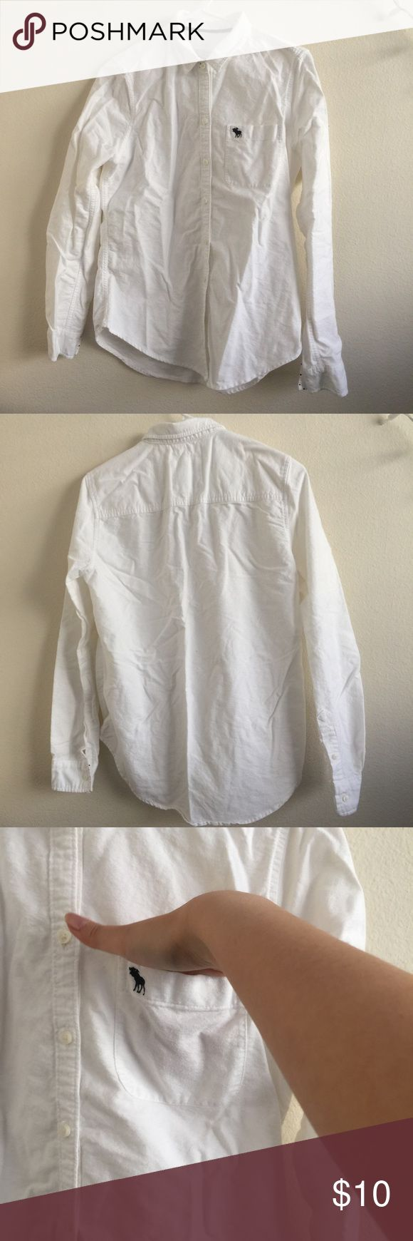 White button down collared shirt White collared button down shirt. Medium weight material. Not sheer. Navy blue polka dot interior to cuffs of sleeves. Double button sleeve closure. Has front pocket. Size medium from Abercrombie and fitch. Never worn!    🚫Trades 🚫Off posh transactions or 🅿️🅿️ 🚫negotiating in comments  🚷lowballs blocked ✅REASONABLE offers ✅Bundle for 30% off for 3 items or more. Abercrombie & Fitch Tops Button Down Shirts