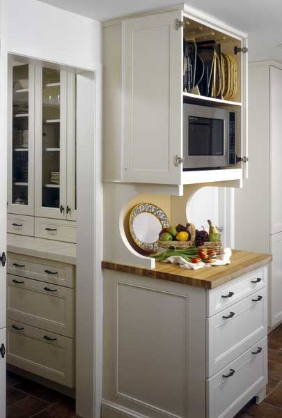 Microwave & baking sheets / cutting boards storage all in upper wall cabinet