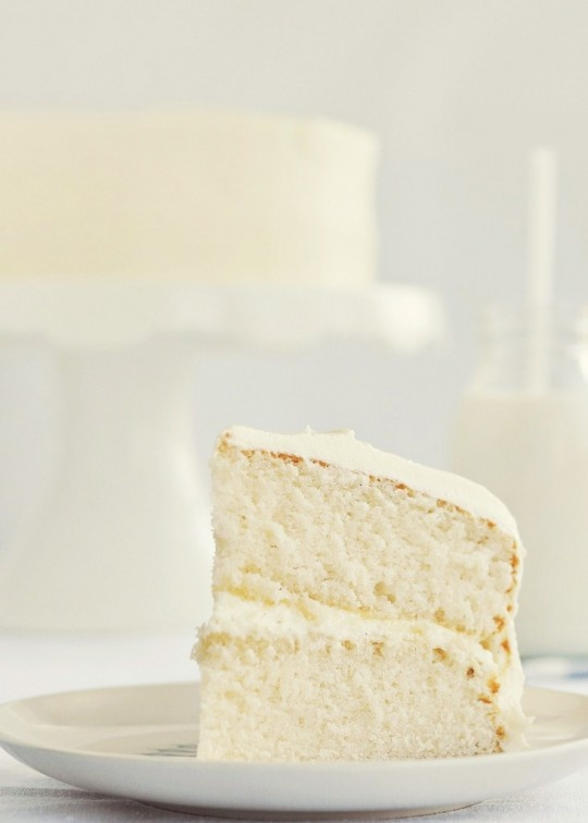 "Fluffy Vanilla Cake: Pinner~This is THE BEST vanilla ""white"" cake (and I have been looking for a really nice one for years.)  It's wonderful.  Fluffy, mildly sweet, moist without crumbling.  Decorates well.  It will rise quite a bit in the pans, so be sure not to overfill, no matter what size pans/cups you use.  FIll them 2/3 full with batter for best result."